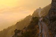 Bcharre, Lebanon - September 9, 2010: An All Terrain Vehicle (ATV) drives at sunset on a mountain highway above the Qadisha Valley near Bcharre, Lebanon.