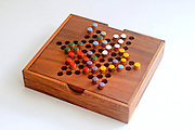 Chinese checkers colour pegs on a wooden board<br /> A game of strategy and planning