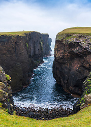 Dramatic cliffs at Calder's Geo on coast at Eshaness at Northmavine , north mainland of Shetland Islands, Scotland, UK