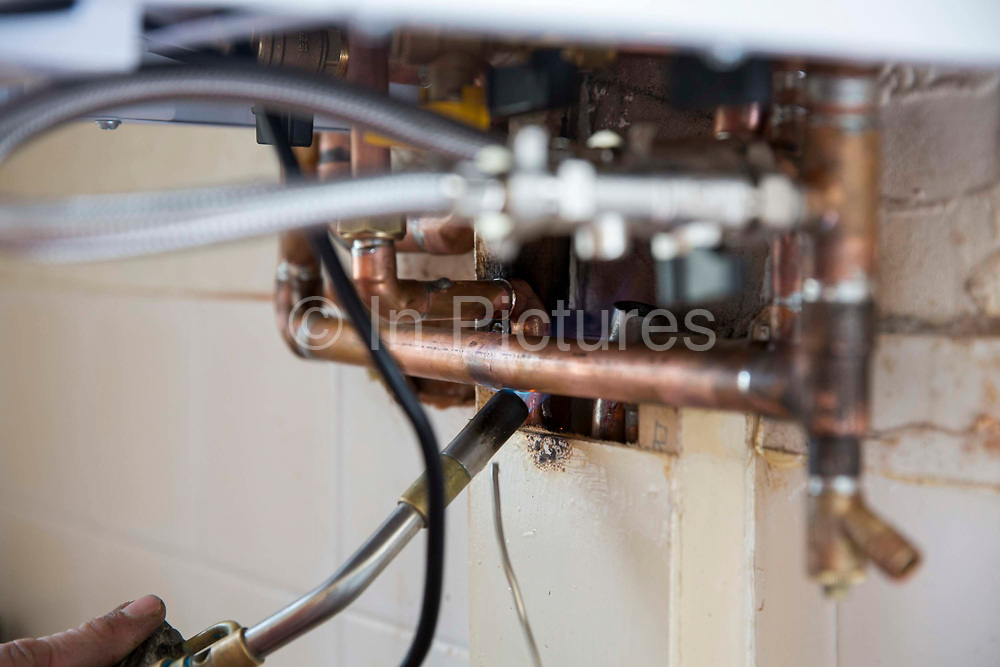 A copper pipe being welded during the instalment of a new boiler  by a Corgi registered plumber. Blackpool, Lancashire. United Kingdom