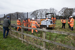 Great Missenden, UK. 18th March, 2021. HS2 contractors erect security fencing in front of works to fell a row of hundred-year-old oak trees in Leather Lane. Almost 40,000 people have recently signed a petition calling for the oak trees lining the ancient country lane not to be felled to make way for a temporary haul road and construction compound in connection with the HS2 high-speed rail link and local residents and conservationists have accused HS2 contractors of destroying active bird boxes on the site.