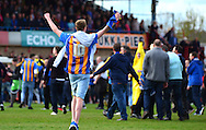Shrewsbury fans invade the pitch at the full time whistle to celebrate during the Sky Bet League 2 match between Cheltenham Town and Shrewsbury Town at Whaddon Road, Cheltenham, England on 25 April 2015. Photo by Alan Franklin.