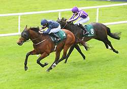 Merchant Navy (left) ridden by jockey Ryan Moore wins the Weatherbys Ireland Greenlands Stakes during day one of the 2018 Tattersalls Irish Guineas Festival at Curragh Racecourse, County Kildare.