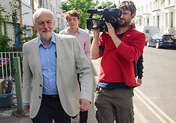 © Licensed to London News Pictures. 10/06/2017. London, UK. Leader of the Labour Party JEREMY CORBYN leaves his London home with his Head of Strategic Communications JAMES SCHNEIDER (rear right). The Labour party made significant gains earlier this week in a general election The Conservative Party were expected to win comfortably. Photo credit: Ben Cawthra/LNP