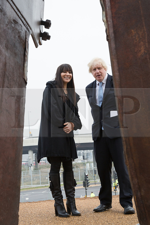 © Licensed to London News Pictures. 17/03/2015. London, UK. Artist, Miya Ando, with Mayor of London, Boris Johnson look at her steel sculpture crafted out of the 9/11 Twin Towers' steel wreckage at the Queen Elizabeth Olympic Park in Stratford today. The artwork by American artist, Miya Ando commemorates the 10th anniversary of the 9/11 attacks and stands at 28 feet tall and weighs over 4 tons. Photo credit : Vickie Flores/LNP