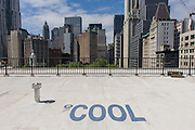 Cool, white roofing materials to cool the roof of a Federal building, on Broadway in New York City.