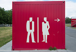 Signs for public toilets on outdoor toilet block