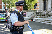 Met Police secure the area where belongings of the suspected perpetrator of Marsham Street are found in St John's Smith Square in central London on Thursday, Aug 15 2019. (Photo/Vudi Xhymshiti)