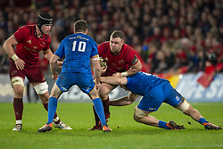 December 30, 2018 - Limerick, Ireland - Dave Kilcoyne of Munster with the ball tackled by Jack Conan and Johnny Sexton of Leinster during the Guinness PRO14 match between Munster Rugby and Leinster Rugby at Thomond Park in Limerick, Ireland on December 29, 2018  (Credit Image: © Andrew Surma/NurPhoto via ZUMA Press)