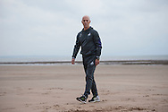 Bob Bradley walks along the beach as  he is officially announced as the new Swansea city manager at a press conference at the Marriott Hotel in Swansea, South Wales on Friday 7th October 2016.  pic by Phil Rees, Andrew Orchard sports photography