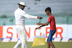 July 14, 2017 - Colombo, Sri Lanka - Sri Lankan cricketer  Angelo Mathews hands over a kite to a child that fell in to the playing area during the first day of the only Test cricket match between Sri Lanka and Zimbabwe at ..R Premadasa International Cricket Stadium,in the capital city, Colombo, ..Sri Lanka on Friday 14 th July 2017  (Credit Image: © Tharaka Basnayaka/NurPhoto via ZUMA Press)