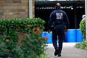 A Dallas police officer walks to the haz-mat staging area outside the apartment where a second Ebola patient has been reported in Dallas, Texas on October 13, 2014. (Cooper Neill for The New York Times)