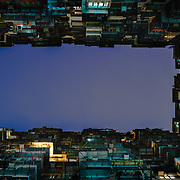 Exterior of old Hong Kong apartment building at night