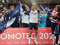 Football - 2020 / 2021 Sky Bet League Two - Crawley Town vs Bolton Wanderers - The People's Pension Stadium<br /> <br /> Antoni Sarcevic of Bolton celebrates with the team after getting Promotion<br /> <br /> Credit : COLORSPORT/ANDRTEW COWIE