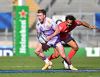 Rugby Union - 2019 / 2020 Heineken Cup - Semi-final - Exeter Chiefs vs Toulouse<br /> <br /> Exeter Chiefs' Stuart Hogg evades the tackle of Toulouse's Yoann Huget, at Sandy Park.<br /> <br /> COLORSPORT/ASHLEY WESTERN