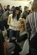 Carmen Kass. Backstage before the Chanel couture fashion show. Grand Palais, Ave Winston Churchill. Paris. 24  January  2006.  ONE TIME USE ONLY - DO NOT ARCHIVE  © Copyright Photograph by Dafydd Jones 66 Stockwell Park Rd. London SW9 0DA Tel 020 7733 0108 www.dafjones.com