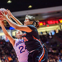 Bloomfield Bobcat Micaela Abeyta (24), left, and Gallup Bengal Leona Smith (33) reach for a rebound during a District 5A semifinal at The Pit in Albuquerque Thursday.  The Bengals fell to the Bobcats 59-56.