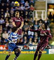 Photo: Gareth Davies.<br />Reading v Bolton Wanderers. The Barclays Premiership. 02/12/2006.<br />Bolton's Kevin Davies (C) rises highest in the air to win the ball.