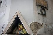 Religious edicola (aedicula votiva) shrine featuring Jesus and the Madonna, Naples, Italy.