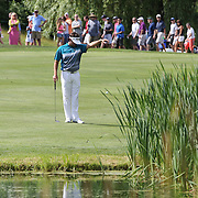 Bubba Watson, USA, takes a drop at the 13th after hitting into the water during the second round of the Travelers Championship at the TPC River Highlands, Cromwell, Connecticut, USA. 20th June 2014. Photo Tim Clayton