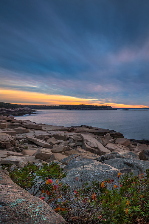 A serene morning begins along one of many granite cliff sides in Acadia, Maine.