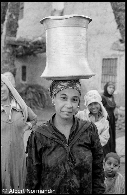 Woman with water bucket on head, Cairo, Egypt, 1996