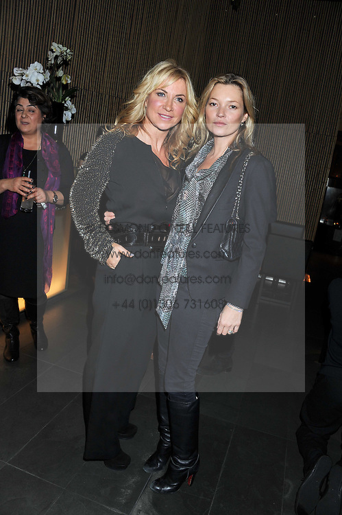 """Left to right, MEG MATHEWS and KATE MOSS at a party to celebrate the launch of Meg Matthews' blog - """"Meg says"""" at the bar at Ni Ju San, 23 St.James's Street, London on 1st December 2011."""
