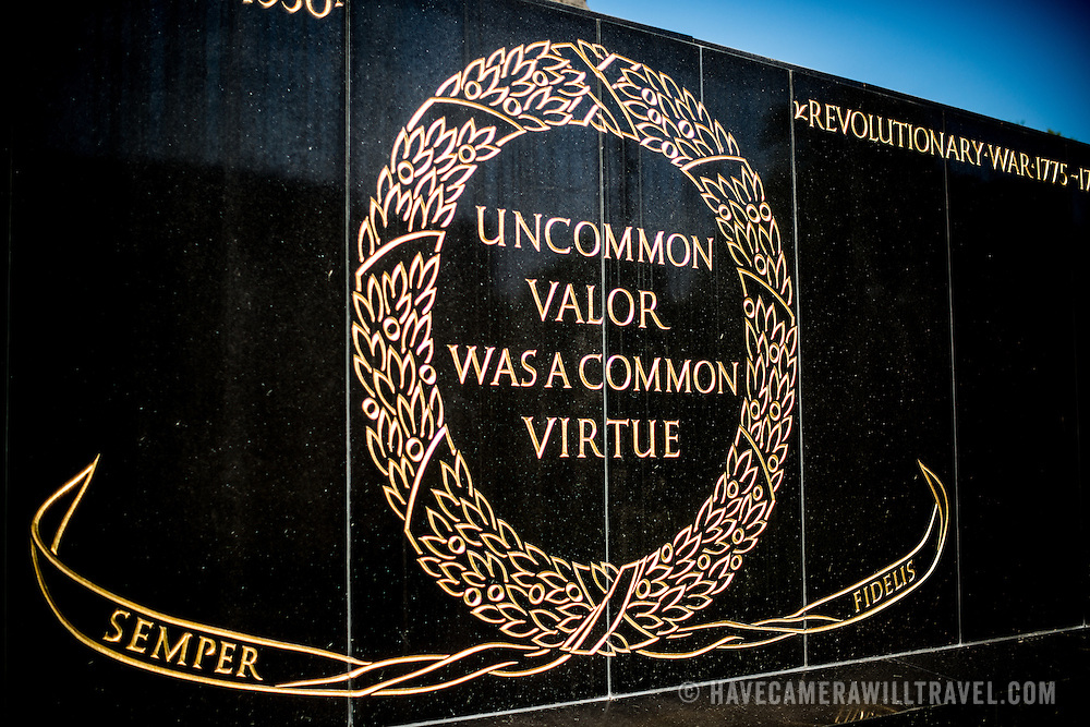 """One of the two inscriptions on the base of the Iwo Jima Memorial (formally the Marine Corps War Memorial) in Arlington, Virginia, next to Arlington National Cemetery. It reads: """"Uncommon valor was a common virtue,"""" a tribute by Admiral Chester Nimitz to the fighting men on Iwo Jima. The monument was designed by Felix de Wledon and is based on an iconic Associated Press photo called the Raising the Flag on Iwo Jima by Joe Rosenthal. It was dedicated in 1954."""