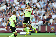 Simon Francis, the Bournemouth captain and Jonathan Calleri of West Ham United compete for the ball. Premier league match, West Ham Utd v AFC Bournemouth at the London Stadium, Queen Elizabeth Olympic Park in London on Sunday 21st August 2016.<br /> pic by John Patrick Fletcher, Andrew Orchard sports photography.