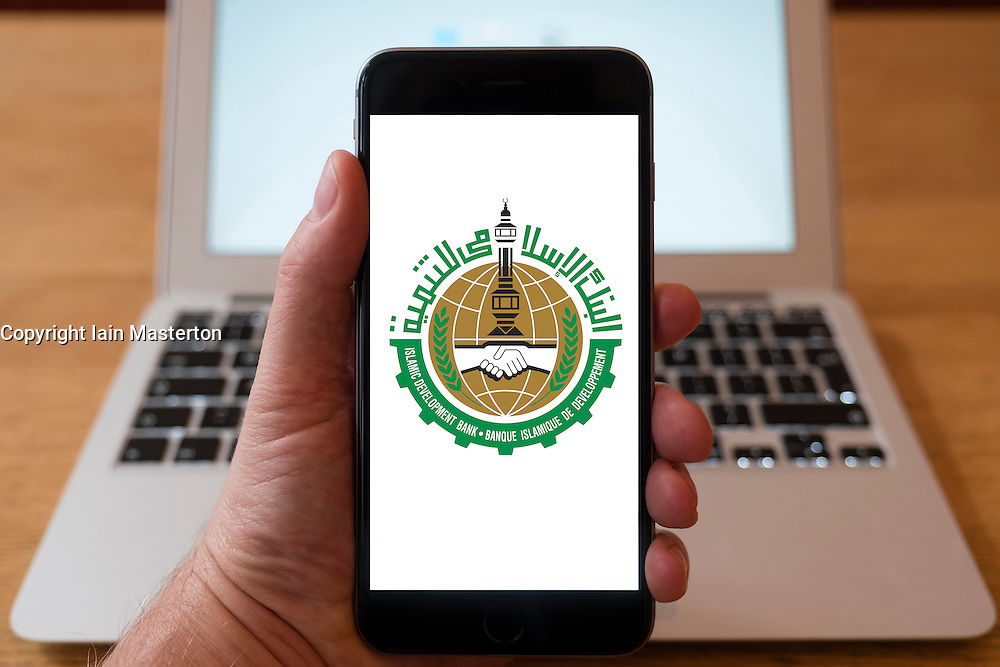 Using iPhone smart phone to display website logo of the Islamic Development Bank is a multilateral development financing institution located in Jeddah