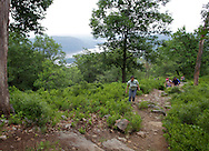 Bear Mountain, New York - People hike up the Appalachian Trail at Bear Mountain on June 5, 2010. The Hudson River is visible in the background.