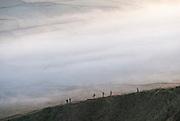 Walkers on the steep ridge of Mam Tor, Peak District