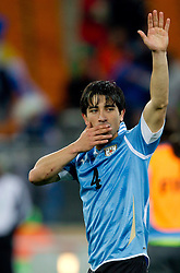 Jorge Fucile of Uruguay celebrates after penalty shots at the 2010 FIFA World Cup South Africa Quarter Finals football match between Uruguay and Ghana on July 02, 2010 at Soccer City Stadium in Sowetto, suburb of Johannesburg. (Photo by Vid Ponikvar / Sportida)