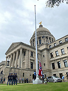 Today is the last day for the Mississippi State flag bearing the Confederate emblem to be flown over the state Capitol. Alfred Thomas, right and Alfred McClinton both employees of the Mississippi State Capitol are seen raising and lowering commemorative State flags. They raised and lowered over 100 flags today, that have been purchased by people from all around the world, and they have each flown over the Capitol, just hours after Governor Tate Reeves signed a historic Bill HB1796 decommissioning the state flag and opening the door to a new flag without the Confederate emblem that has flown for 126 years.Photo copyright © Suzi Altman @suzialtman #mississippi #flag #history #change #equality #progress #confederateflag
