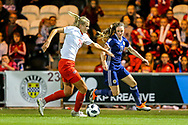 Rahel Kiwic (#14) of Switzerland defends the ball against the challenge from Lisa Evans (#11) of Scotland during the 2019 FIFA Women's World Cup UEFA Qualifier match between Scotland Women and Switzerland at the Simple Digital Arena, St Mirren, Scotland on 30 August 2018.