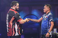 Cristo Reyes wins his first round match against Lourence Ilagan during the PDC William Hill World Darts Championship at Alexandra Palace, London, United Kingdom on 17 December 2019.