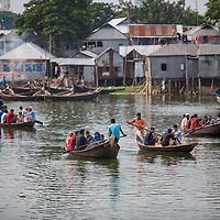 Passengers are ferried across water in Dhaka, Bangladesh.