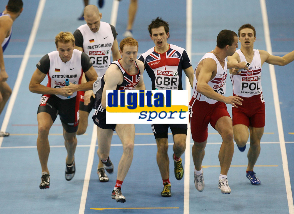 Photo: Rich Eaton.<br /> <br /> EAA European Athletics Indoor Championships, Birmingham 2007. 04/03/2007. Steven Green 2nd left takes the baton to run the final leg of the mens 4-400m relay in which Great Britain win silver