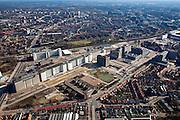"""Nederland, Noord-Brabant, Eindhoven, 07-03-2010; Strijp-S, voormalige Philipsterrein, was niet toegankelijk voor het publiek, 'de verboden stad'. Boven in beeld Philitefabriek / Klokgebouw (Strijp S), in het midden het Veemgebouw met daar direct naast De Hoge (Witte) Rug. Meer onder in beeld, in baksteen het voormalige NatLab. Het gebied, met diverse Rijksmonumenten, wordt ontwikkeld voor wonen, werken en cultuur..Strijp-S, former Philips area, was not accessible to the public, """"the forbidden city"""". Top image Philitefabriek / Clock Building (Strijp S), in the middle of the Veemgebouw  next to the High (White) Back. Bottom in the former NatLab (brick building). The area, with several national monuments, is designated for living, working and culture..luchtfoto (toeslag), aerial photo (additional fee required).foto/photo Siebe Swart"""