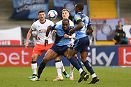 Wycombe Wanderers forward Uche Ikpeazu (9) battles for possession  with Luton Town defender James Bree (26) during the EFL Sky Bet Championship match between Wycombe Wanderers and Luton Town at Adams Park, High Wycombe, England on 10 April 2021.