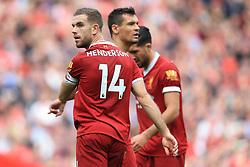 14th October 2017 - Premier League - Liverpool v Manchester United - Jordan Henderson of Liverpool (L) and teammate Dejan Lovren (C) - Photo: Simon Stacpoole / Offside.