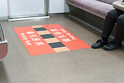 Priority seat sign on floor in train Japan Kyoto