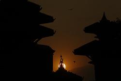 November 22, 2018 - Kathmandu, Nepal - The sun sets behind a pinnacle of a temple in Kathmandu, Nepal. (Credit Image: © Skanda Gautam/ZUMA Wire)