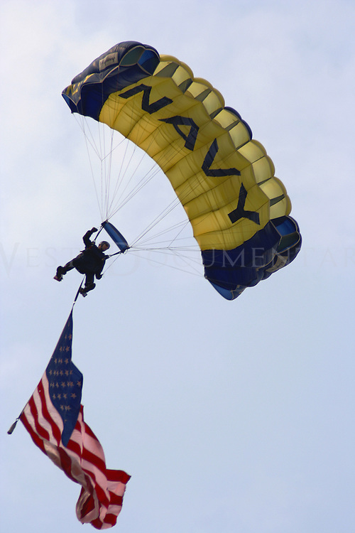 """The Navy's elite special jump unit, nicknamed the """"Leapfroggers"""", glide in for a landing during the National Anthem at the Pittsburgh Air Show on July 9, 2006."""