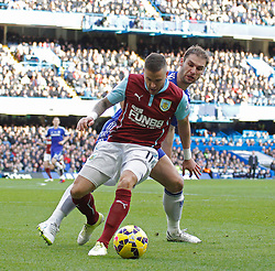 Burnley's Michael Kightly and Chelsea's Branislav Ivanovic compete for the ball - Photo mandatory by-line: Mitchell Gunn/JMP - Mobile: 07966 386802 - 21/02/2015 - SPORT - Football - London - Stamford Bridge - Chelsea v Burnley - Barclays Premier League