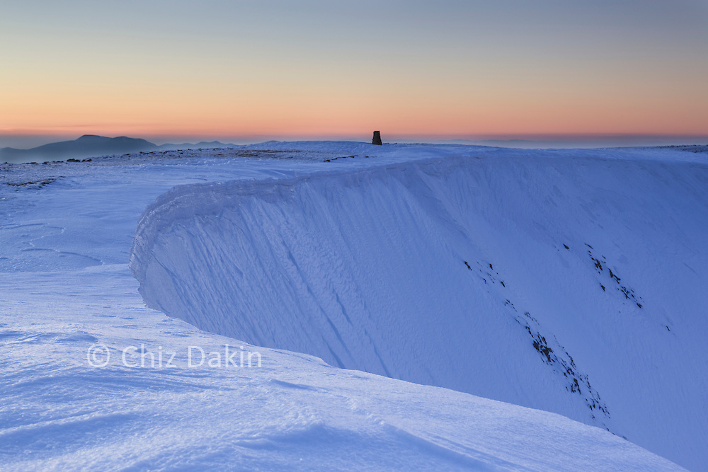 The edge between the cross-shaped stone shelter on Helvellyn and Swirral Edge can sometimes form dangerous cornices in winter.