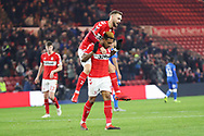 Middlesbrough midfielder Lewis Wing (26) jumps on the back of Middlesbrough forward Britt Assombalonga (9) after he scored his team's fourth goal during The FA Cup 3rd round match between Middlesbrough and Peterborough United at the Riverside Stadium, Middlesbrough, England on 5 January 2019.