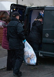 © Licensed to London News Pictures. 17/03/2019. London, UK. Officers remove evidence from a house in Viola Avenue in Stanwell after police said that they are treating a stabbing incident last night as a terrorism. Counter Terrorism Policing South East are leading an investigation into an incident last night, which has now been declared a terrorist incident, following the arrest of a man on suspicion of attempted murder and racially aggravated public order in Stanwell. Photo credit: Peter Macdiarmid/LNP