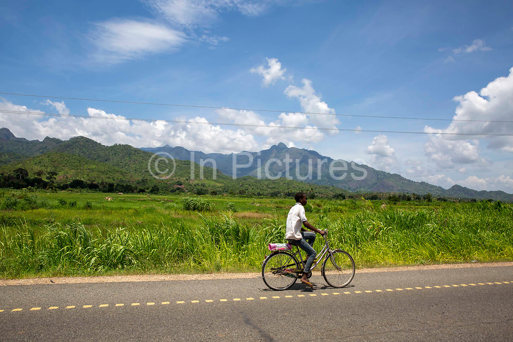A child cycling home after a morning at school along the B127 road between Hembeti Village and Kigugu on 19th November 2019 in Mvomero district, Morogoro region, Tanzania.