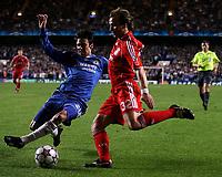 Photo: Paul Thomas.<br /> Chelsea v Liverpool. UEFA Champions League. Semi Final, 1st Leg. 25/04/2007.<br /> <br /> Paulo Ferreira (L) of Chelsea tackles Bolo Zenden.